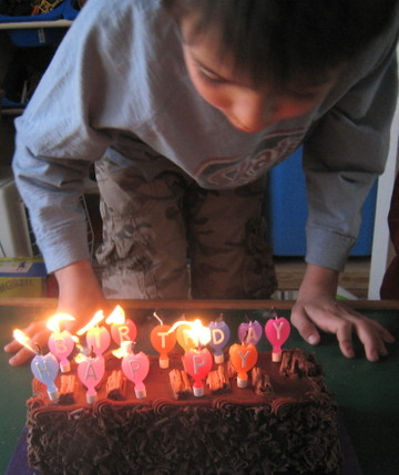 Luca_blowing_candles